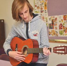 trainee playing the guitar